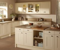 photo of shaker cream taupe premier kitchens kitchen with granite worktop tiled floor kitchen island and glass fronted cabinet