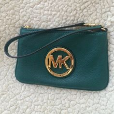 Michael Kors wristlet Emerald Green Michael Kors wristlet! Can be used as small purse or wallet. Only been used once and is in perfect condition! Michael Kors Bags Wallets