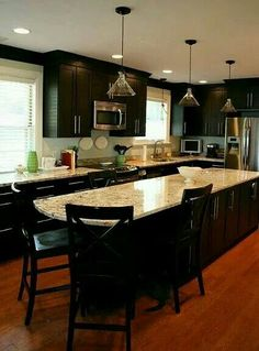 Black cabinets with light granite