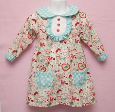 Gorgeous vintage-inspired dress by http://sewcando.blogspot.com/ I heart the heart shaped buttons!!