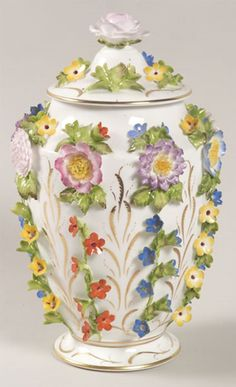 A flower encrusted Urn with cover Coalbrookdale by Coalport China