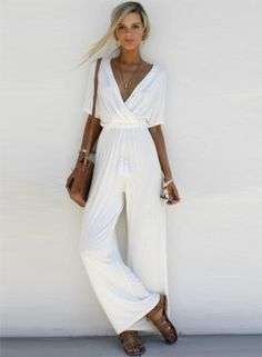 The jumpsuit is featuring v neck, short sleeve, solid color, wide-leg style and loose fit.