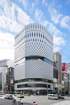 Over 5,000 aluminium panels create the perforated facade of this building by Klein Dytham Architecture, which overlooks Tokyo's most iconic intersection