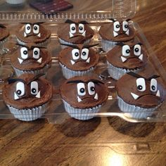 Goomba cupcakes for a Super Mario themed party made by Play Date Cupcakes in Hawaii. Dark chocolate buttercream on yellow cupcakes with fondant face decorations.