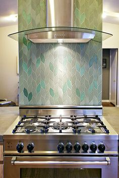 I would have this leaf shaped tile in another house.  It's probably too trendy for this one...