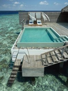 Beautiful pool with a house on clear water