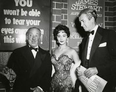 """Jimmy Stewart, Alfred Hitchcock and actress Marla English at the premiere of """"Rear Window"""", 1954"""