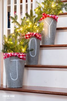 Stuff galvanized flower buckets with fresh pine, drawn on a festive message and light it all up with twinkly lights! Get the tutorial at Finding Home Farms » What you'll need: chalk pen ($3, amazon.com), galvanized buckets ($18, amazon.com), Christmas lights ($9, amazon.com)
