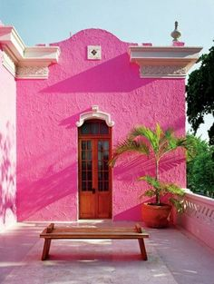 This is a new take on the Greek white and blue. I think this would be in South America. I like the pink wall and think it would be nice as a feature wall in a courtyard. A whole building painted lolly pink would be too much though!