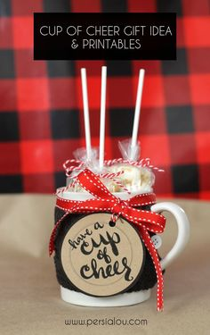 "Cute teacher or neighbor gift idea for Christmas - add hot chocolate to a mug with free ""cup of cheer"" printable"