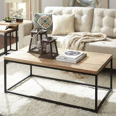 """Named for the Hindi word meaning """"strength"""" or """"stamina,"""" our Takat Coffee Table makes a powerful statement. The sturdy black iron frame, clean lines and warm mango wood tabletop are at home almost anywhere, whether the rest of your carefully curated decor is industrial chic or modern minimalist. And thanks to natural variations in the wood, each tabletop is subtly unique—like you. A powerful statement, indeed."""