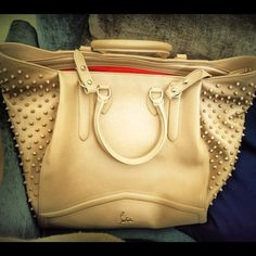 i just love this purse. spikes/studs & love the color. it would get so dirty with me though :/