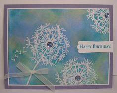 What a lovely way from Kris Chirhart to use the May 2012 Greenhouse Society stamp set from Technique Tuesday on a card. She randomly stamped the dandelion, heat embossed it and then sponged ink over the top of it.