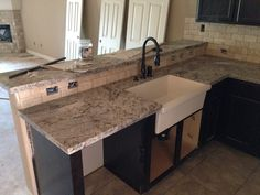 Farm Sink and cold spring granite countertop