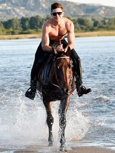 Star Tracks: Wednesday, July 9, 2014 | LET IT RIDE | Lucky horse! While vacationing in Sardinia, Italy, with rumored new gal pal Michelle Rodriguez (not pictured), Zac Efron goes shirtless (thank you!) for a Monday horseback ride.