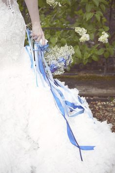 Pretty gypsophila wedding bouquet with blue ribbon streamers, from 'Something Blue ~ A Pretty Wedding Inspired by an Ocean Lagoon'.  Photography http://www.nataliejweddings.com/