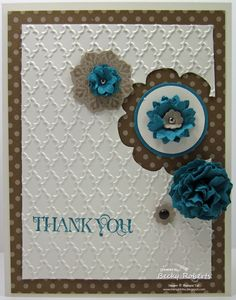 Cardstock:  Whisper White, Island Indigo, Neutrals Designer Series Paper  Stamp Set:  Daydream Medallions, Curly Cute  Accessories:  Floral Framelits, Fancy Fan Folder, Big Shot, Boho Blossom Punch, Flower from Itty Bitty Shapes Pack, Mini Brads, Neutrals Brads