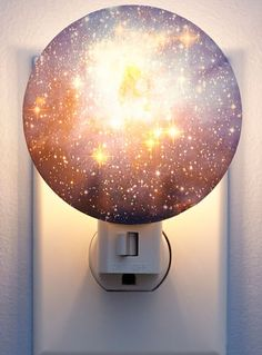 A nebula night light will give your space an additional glow. | 23 Magical Ways To Bring The Night Sky Into Your Bedroom