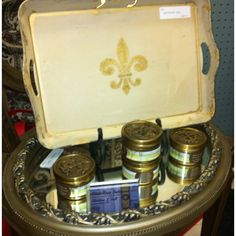 Hand-painted Fleur-de-lis tray and Low Country Luxe candles.