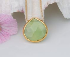 A beautiful light faceted green chalcedony necklace with a gold chain, , ,