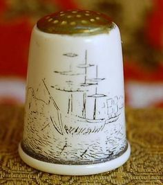 VINTAGE THIMBLE BRASS BOAT SAILBOAT BOAT METAL CERAMIC COATED BLUE WHITE.