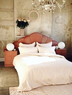 Marbled rose quartz bed linen from the 2 lovely gays and Secret Linen Store. I love this interior styling! So glam. The bare plaster walls are incredible.