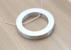 https://www.etsy.com/be-fr/listing/161790213/bijoux-minimaliste-minime-collier-cercle?ga_order=most_relevant