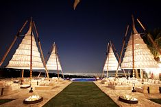 Four 40-foot-tall cones of bamboo, steel and organic cotton at a Beverly Park affair.