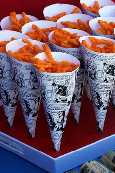 Comic book page cones hold Cheetos or other crunchy. Could do with spaced themed paper for party :)
