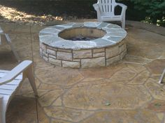 Concrete fire pit on stamped patio