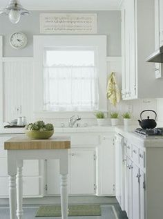 Small Kitchen: run the cabinetry up to the ceiling. This will give you an extra foot of storage space all the way around the room. Use light colors to make room seem larger
