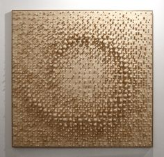 Korean sculptor Cha Jong-Rye works with wood as if it were clay or paint. She layers and sands hundreds of delicate wood pieces to create pockmarked canvases, threatening beds of thorns, or wall-sized recreations of crumpled cloth napkins.