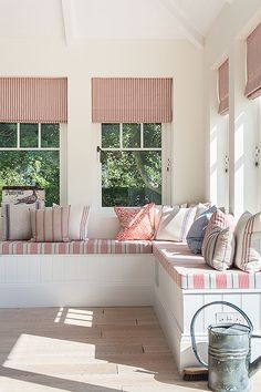corner bench seat in an open plan dining room new england style weatherboard coastal house in England