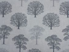 A quirky and simple repeated tree design in different tones of duck egg blue on a grey background http://www.fabricmills.co.uk/fabric/fabrics/product/3895-tree-rpeat-in-duck-egg-fm4534.html#