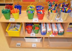 Organizing the kindergarten classroom. I really like the idea of each table color having their own color supply containers.