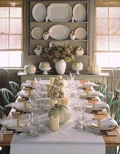simple neutral fall table featuring white pumpkins