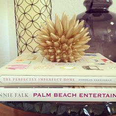 Book stack w/ matte gold sea urchin.