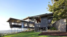 Australian studio Bark Design Architects has designed the Maleny House.    This two story contemporary home is located in the Sunshine Coast region in South East Queensland, Australia.