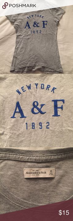 """Abercrombie Gray Cap Sleeve Embroidered Tee This is a size XS grey Abercrombie and Fitch cap sleeve t-shirt with blue embroidered detailing on the front. There is nothing on the back.  Measurements   Chest 32"""" Length 28"""" Waist 23.75"""" Abercrombie & Fitch Tops Tees - Short Sleeve"""