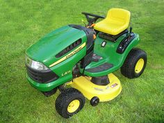 A classic John Deere Lawn Mower--Molly used to have a Tractor like this!