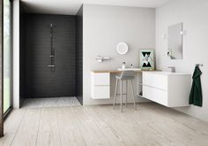 Mano by Kvik: Simple, clean lines with white doors without handles. Elegant well-being with matt white doors without handles. Easy to expand with smart solutions if you need more storage space.