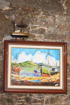 Quadro náutico, pintado pelo meu pai, e barco de pesca em miniatura