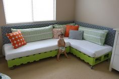 DIY Pallet Bed. I might use this tutorial to make my kids room sofas.