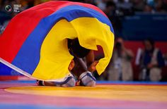 Day 13 - Colombia's Jackeline Renteria Castillo celebrates after defeating Ukraine's Tetyana Lazareva for the bronze medal of the Women's 55Kg Freestyle wrestling at the ExCel venue during the London 2012 Olympic Games. DAMIR SAGOLJ/REUTERS