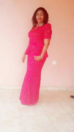 Red fitted gown. Design by KE&T stitches.