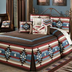 Frontier Grande Fitted Bedspread has a dash-quilted chocolate center, framed in blue followed by channel-quilted chocolate. Pieced and quilted drop has Southwest emblems and stripes. Corners have chocolate inserts. Bedspread reverse is chocolate cotton.