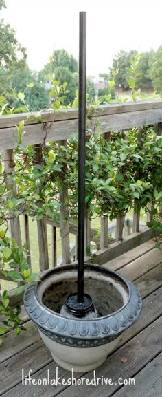 DIY Solar Light Lamp Post, Rust-Oleum Hammered spray paint- I love that the pole is cemented into a lightweight plastic container first, then placed in the planter.  Lighter to carry, easier to put away at end of season. ~A.