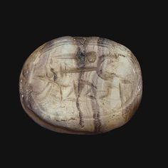 A WEST SEMITIC BANDED AGATE SCARABOID CIRCA 8TH-7TH CENTURY B.C.