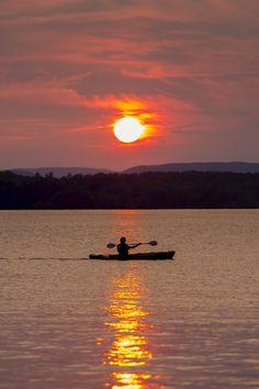 A lone kayaker makes his way across 19 Mile Bay on Lake Winnipesaukee in Tuftonboro, N.H. Tony Baldasaro, Your Take