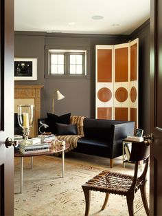 Corner wall screen or room divider.  Rectangles and circles. Ken Fulk